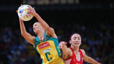 Kimberley Ravaillion of Australia catches the ball under pressure from Jade Clarke of England.