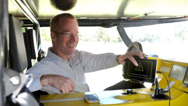 Cohda's Paul Alexander in a solar car fitted with the company's anti-collision technology kit.