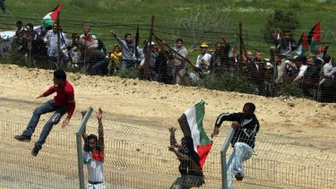 Infiltration ... Palestinian protesters at the border fence.