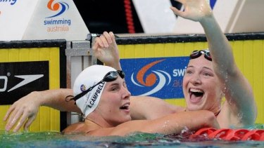Cate Campbell (right) celebrates with her sister, Bronte, after winning the women's 100 metre freestyle event on Saturday.