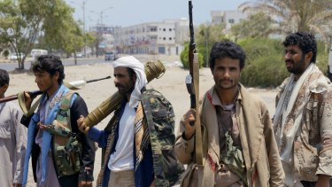 Houthi fighters gather at a street in Aden, Yemen. The Shiite rebels and their allies fought their way through the commercial centre of Aden on April 2.