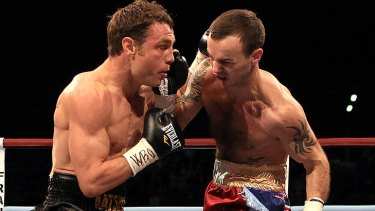 Michael Katsidis does battle with Kevin Mitchell.
