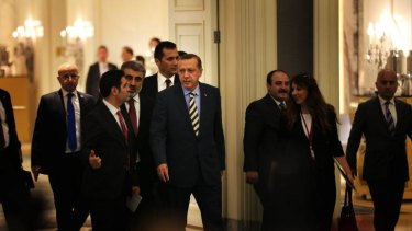 Centre of power: Recep Tayyip Erdogan (in striped tie) arrives at Istanbul's Shangri-La Hotel on May 29 to sign off on a natural gas project with Azerbaijan.