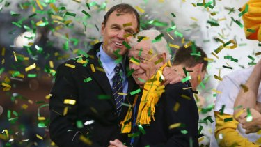 Fond memories: Former Socceroos coach Holger Osieck celebrates qualifying for the 2014 World Cup with Frank Lowy.