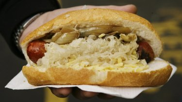 A fine Melbourne dining tradition: A sizzling bratwurst from the Victoria Market.