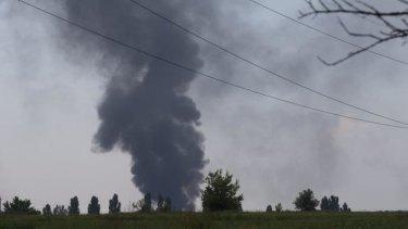 Black smoke rises from the downed Ukrainian Army helicopter outside Slovyansk on Thursday.