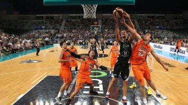 Battle for possession: Melbourne United centre Daniel Kickert and Cairns counterpart Matthew Burston vie for a rebound.