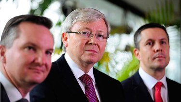 Prime Minister Kevin Rudd, pictured with Chris Bowen and Mark Butler, says the early move to an emissions trading scheme will save an average household around $380 next financial year.