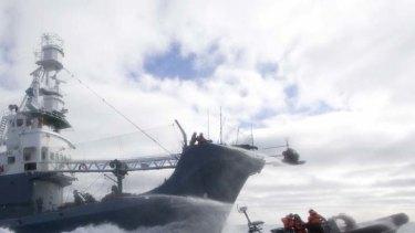 Hard-fought ... a Sea Shepherd crew is hosed down.