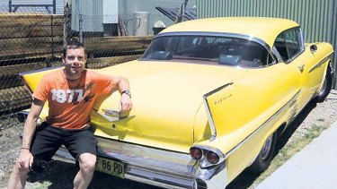New toy: Cadel Evans and his Cadillac Coupe, a gift for winning the Tour de France.