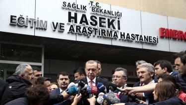 Turkish President Recep Tayyip Erdogan (centre) outside an Istanbul hospital.