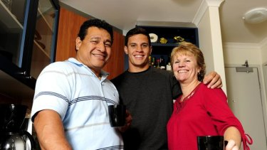 Brumbies flyhalf Matt Toomua, centre, in his Manuka flat with parents Ieru and Karen Toomua.