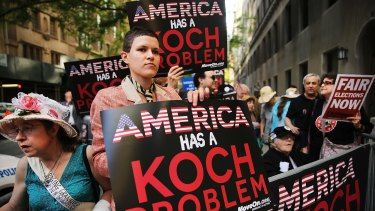 Activists hold a protest near the Manhattan apartment of billionaire and Republican financier David Koch in New York City last year.