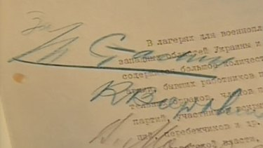 Written in blood ... the signatures of Stalin and three Politburo members on the paper approving the execution.