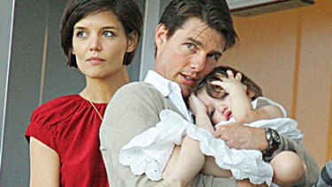 You'd think she was an only child ... Tom Cruise with wife Katie Holmes and their daughter Suri Cruise.