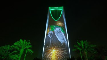 The images of King Salman and Crown Prince Mohammed bin Salman are projected on the Kingdom Tower during National Day ceremonies in Riyadh, Saudi Arabia.