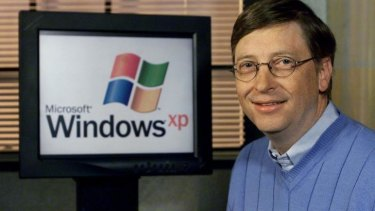 """Microsoft chairman and then chief software architect Bill Gates next to a computer with Windows XP (previously code-named """"Whistler"""") at the time of  launch in 2001."""