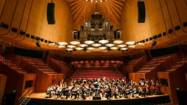 The World Orchestra conducted by Sir Simon Rattle during reharsals in the Concert Hall at the Sydney Opera House.