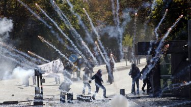 Kurdish demonstrators clash with riot police outside of the Middle Eastern Technical University (METU) in Ankara over Turkey's inaction on Kobane.