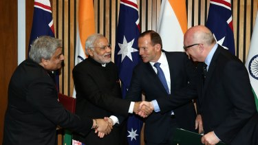 Anil Wadhwa, Secretary (East) Ministry of External Affairs, Indian Prime Minister Narendra Modi, Prime Minister Tony Abbott and Attorney-General Senator George Brandis at Parliament House in Canberra last year.