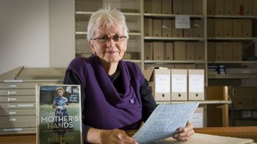 Author Biff Ward with her book <i>In My Mother's Hands</i>.