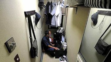 "Hidefumi Ito, 53, gets online in a ""net room""."