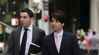 Fadi Ibrahim (right), with his lawyer Nicholas Hana, arrive at court for the opening of the trial.