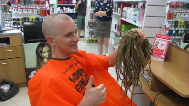 Freelance journalist Andrew McMillen says goodbye to his dreadlocks.