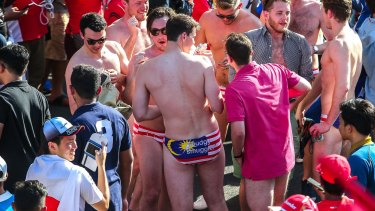 Nine Australian revellers at Malaysia's formula 1 racing circuit have been jailed after stripping down to reveal underpants themed on Malaysia's national flag.