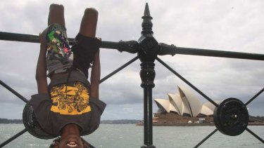 "Perfect position ... Delwyn ""D.J."" Gothachalkenin, 9, from the far north Queensland Aboriginal community of Arukun, was rewarded with a trip to Sydney for New Year's Eve for good school attendance last year."