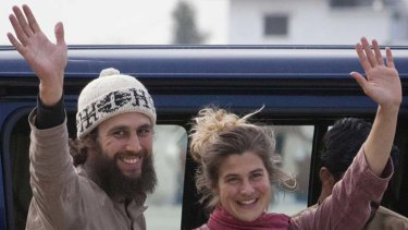 Swiss nationals Olivier David Och and Daniela Widmer wave to the media at a military base near Islamabad.
