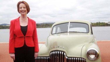 Prime Minister Julia Gillard with the first Holden that came off the line in 1948.