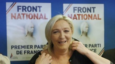 Marine Le Pen, France's National Front political party head, reacts to results after the polls closed in the European Parliament elections.