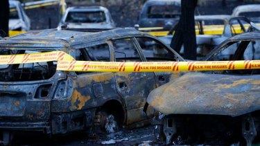 Destruction: burnt vehicles remain parked at Homebush Aquatic Centre.