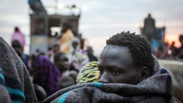 Escaping the fighting: Civilians fleeing violence in the Bor region cross the Nile River.