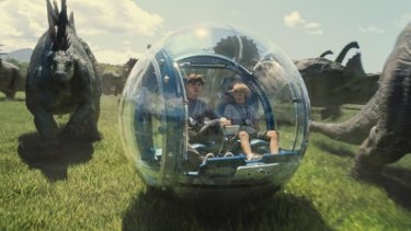 Nick Robinson as Zach and Ty Simpkins as Gray in <i>Jurassic World</i>, directed by Colin Trevorrow.