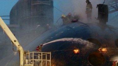 Firemen battle the blaze aboard the Yekaterinburg.