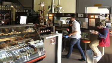 Bean encounter … customers can view the coffee-roasting room through a large internal window.