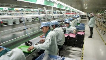 On the line: Workers assemble keyboards at the Logitech International factory in Suzhou, Jiangsu province.