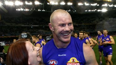 Favourite player ... Julia Gillard with Barry Hall after the Bulldogs thumped North Melbourne yesterday.