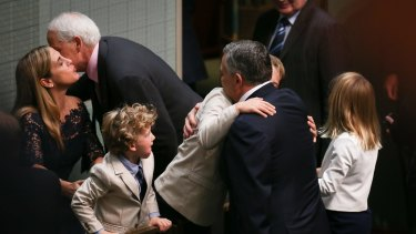 Treasurer Joe Hockey with his children Ignatius, Xavier and Adelaide Hockey after handing down the budget on Tuesday.
