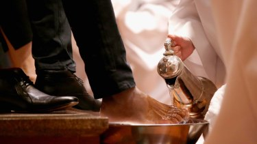 The Reverend Canon Heather Patacca washes feet during the Choral Eucharist on Thursday at St Paul's Cathedral.