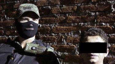 Under guard ... a soldier with Edgar Jimenez.