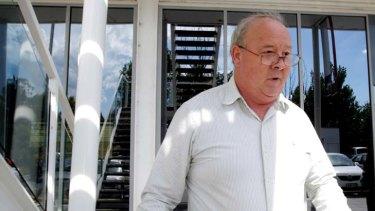 John Alan Jones leaves the hearing.
