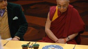 Reflective ... The Dalai Lama is served.
