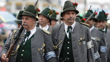 Bavarian riflemen in traditional costumes arrive for a salute shooting in front of the 'Bavaria' statue on the last day of the 184th Oktoberfest beer festival in Munich, Germany.