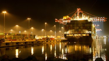 Floodlights are no guarantee of security as a container ship's freight is unloaded at the Melbourne docks.