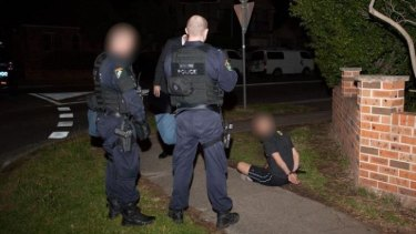 NSW Police officers execute search warrants in raids across Sydney on Thursday, September 18.