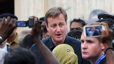 Mobbed by Tamil protesters: British Prime Minister David Cameron visits the former war-torn city of Jaffna, some 400 kilometres north of Colombo.