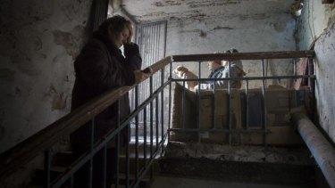 War: People hide from shelling near Donetsk airport.